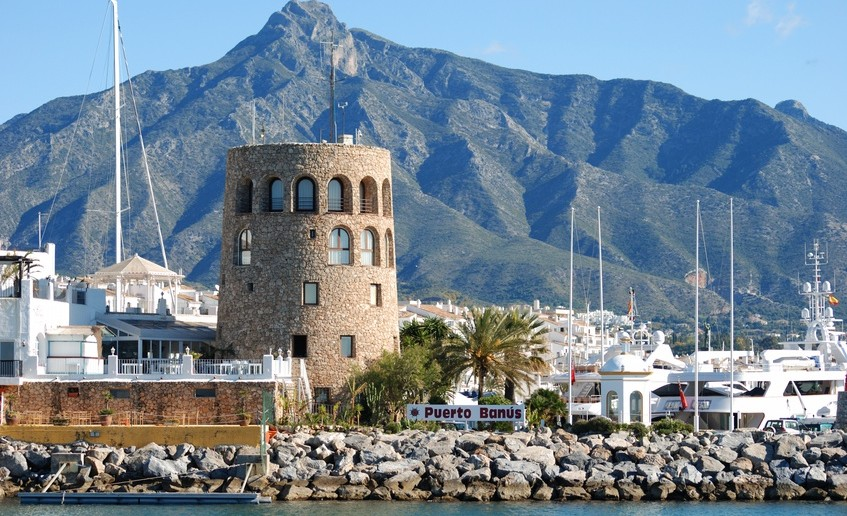 Harbour entrance with the watchtower to the left and La Concha mountain to the rear, Puerto Banus, Marbella, Costa del Sol, Malaga Province, Andalucia, Spain, Western Europe.
